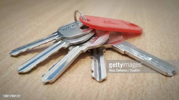 close-up of key ring on table - key ring stock photos and pictures