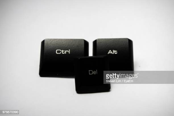 Close-Up Of Keyboard Buttons Over White Background
