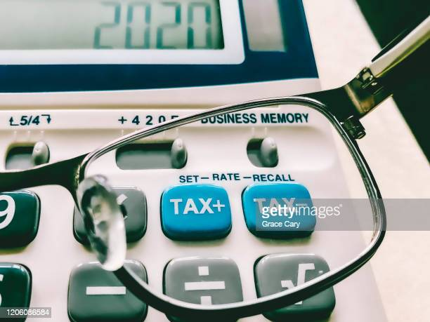 close-up of keys on business and tax calculator - tax stock pictures, royalty-free photos & images