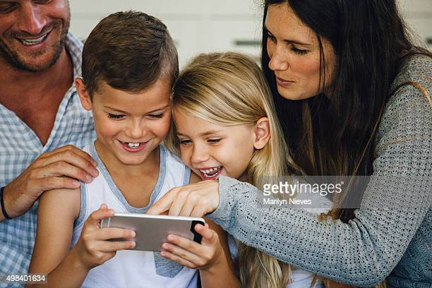 closeup of kids playing games with parents