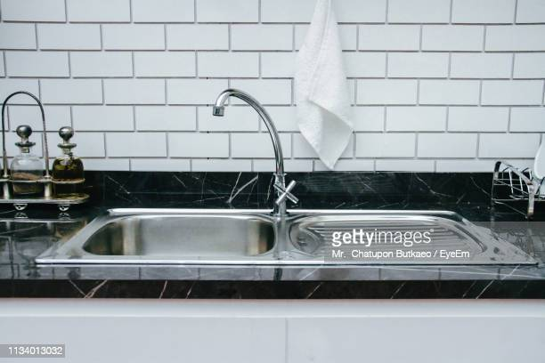 close-up of kitchen sink at home - kitchen sink stock pictures, royalty-free photos & images