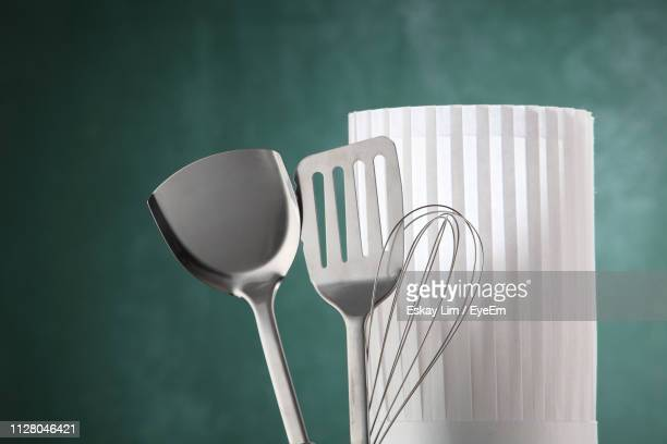 close-up of kitchen utensils with chef hat - chef's hat stock pictures, royalty-free photos & images