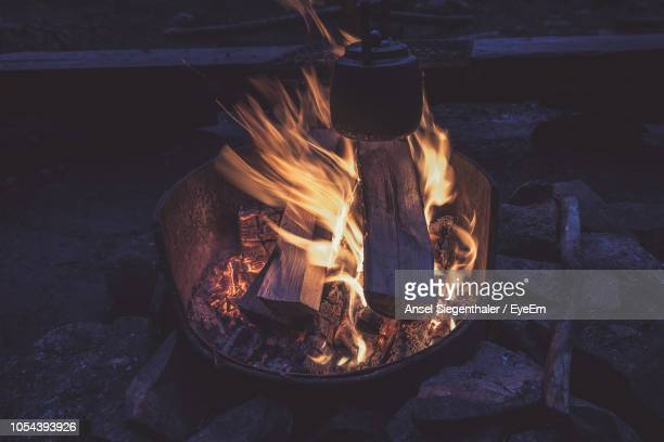 Close-Up Of Kittle On Fire Pit