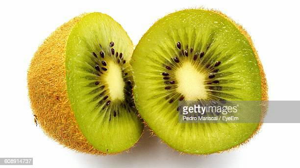 Close-Up Of Kiwi Against White Background
