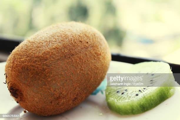 Close-Up Of Kiwi By Window On Table