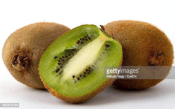Close-Up Of Kiwis On White Background