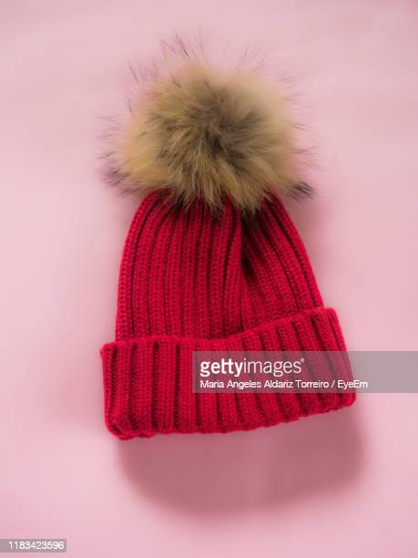 close-up of knit hat against pink background - knit hat stock pictures, royalty-free photos & images