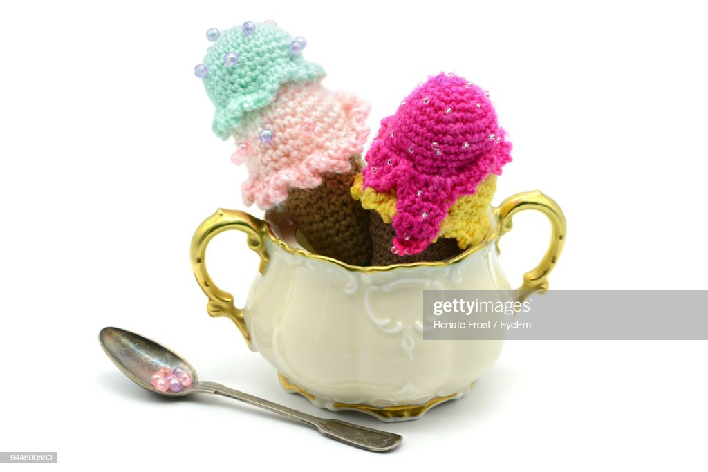 Close-Up Of Knitted Ice Cream Cones In Container Against White Background : Stock Photo