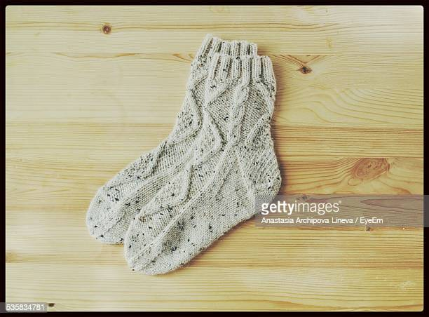 Close-Up Of Knitted Socks On Wooden Table
