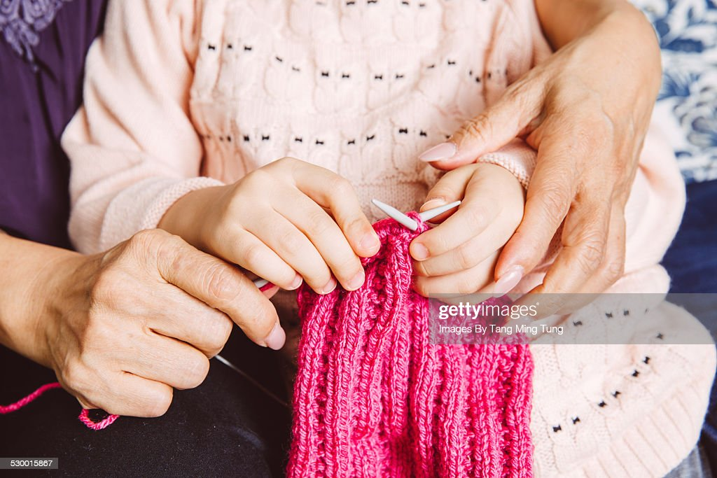 Closeup of knitting hands of grand daughter : Stock Photo