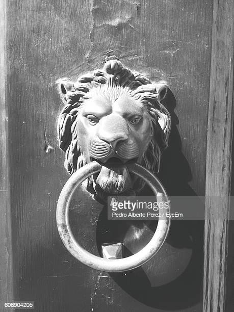 close-up of knocker on door - door knocker stock photos and pictures
