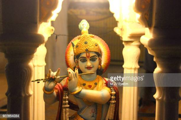 close-up of krishna statue in temple - lord krishna stock photos and pictures