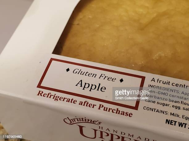 Close-up of label on apple pie describing the pie as Gluten Free, San Ramon, California, November 27, 2019. Many people are embracing a gluten free...