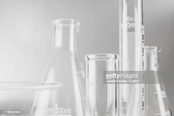 close-up of laboratory glassware against white background - laboratory glassware stock pictures, royalty-free photos & images