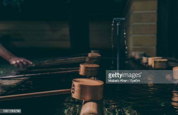 close-up of ladles at japanese fountain - shrine stock pictures, royalty-free photos & images