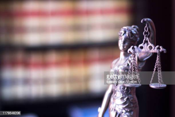 close-up of lady justice figurine in courtroom - 正義 ストックフォトと画像