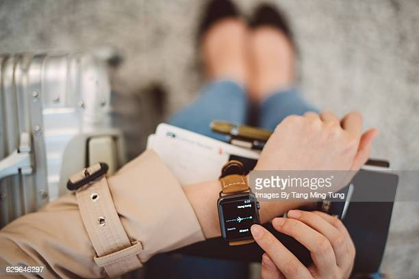 a closeup of lady's hand using smart watch - convenience stock photos and pictures