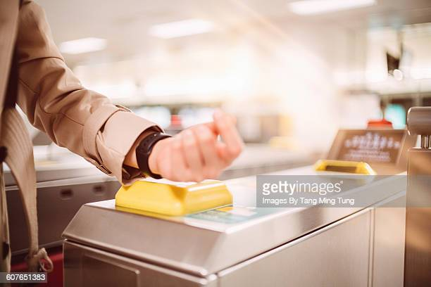 closeup of lady's hands paying at turnstile - nfc stock pictures, royalty-free photos & images