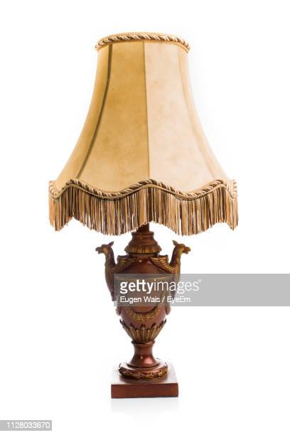 close-up of lamp against white background - electric lamp stock pictures, royalty-free photos & images