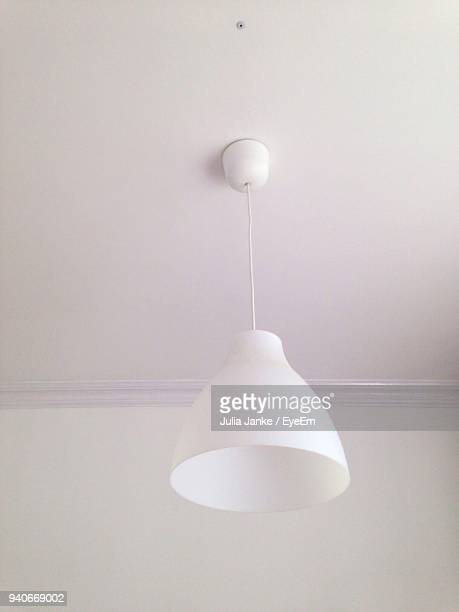 Close-Up Of Lamp Hanging From Ceiling