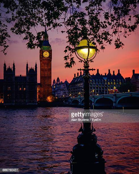 Close-Up Of Lamp Post By River Against Big Ben At Dusk In City