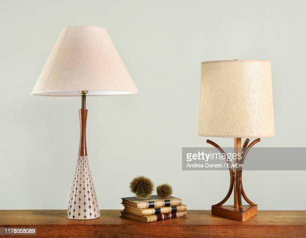 close-up of lamps on table against wall at home - household fixture stock pictures, royalty-free photos & images