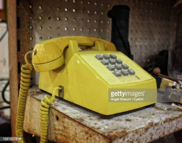 Close-Up Of Landline Phone On Table