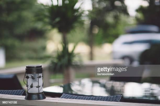 close-up of lantern on table - bortes foto e immagini stock