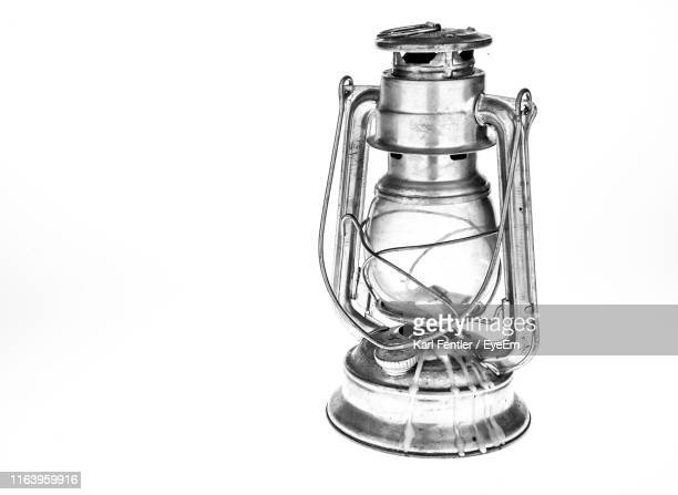 close-up of lantern over white background - oil lamp stock pictures, royalty-free photos & images