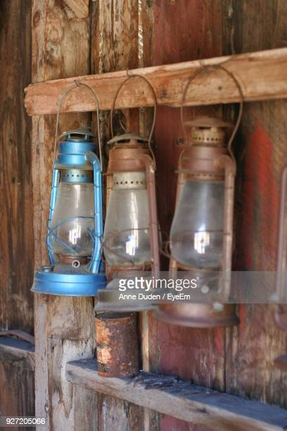 Close-Up Of Lanterns Hanging On Wooden Wall
