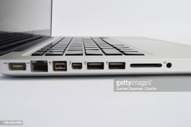 close-up of laptop ports against white background - datorport bildbanksfoton och bilder