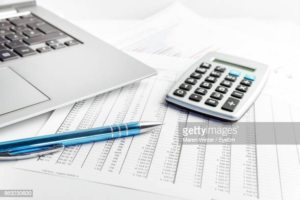 close-up of laptop with office supplies on table - input device stock photos and pictures