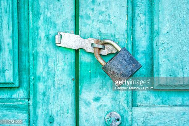 Close-Up Of Latch On Wooden Blue Door