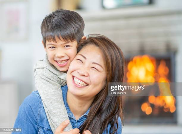 closeup of laughing mom and son - fatcamera stock pictures, royalty-free photos & images
