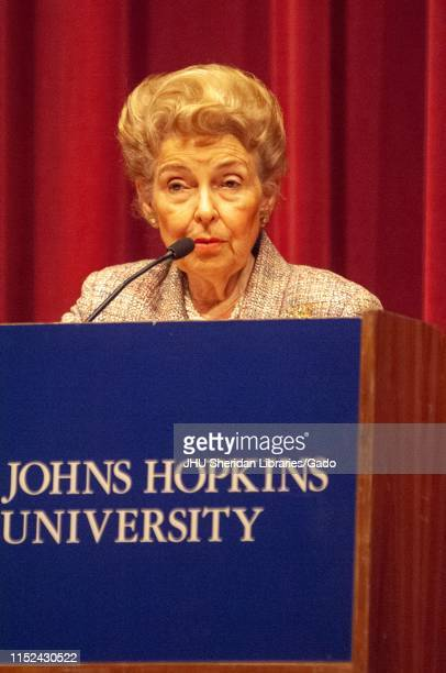 Closeup of lawyer and activist Phyllis Schlafly standing behind a podium while speaking during a Milton S Eisenhower Symposium Homewood Campus of...