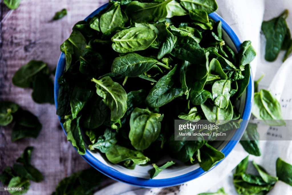 Close-Up Of Leaf Vegetables In Bowl On Table : Stock Photo