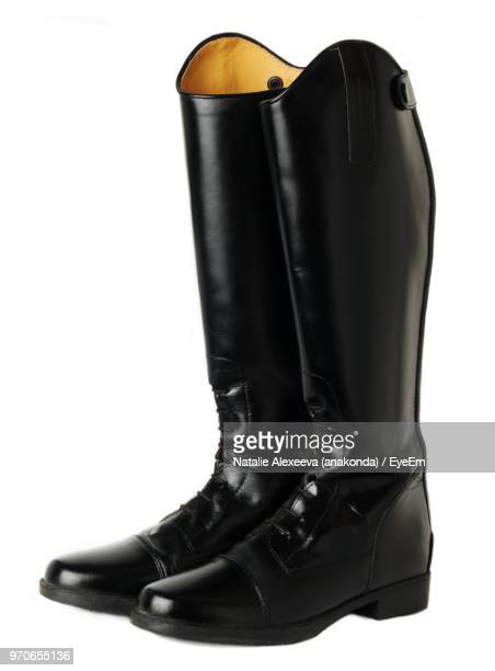 close-up of leather boots over white background - leather boot stock pictures, royalty-free photos & images