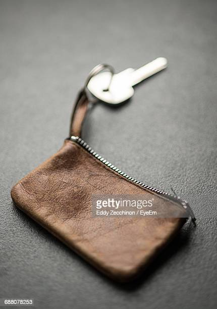 Close-Up Of Leather Pouch With Key On Table
