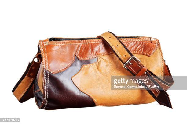 Close-Up Of Leather Purse Against White Background