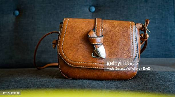 close-up of leather purse on seat - evening bag stock pictures, royalty-free photos & images