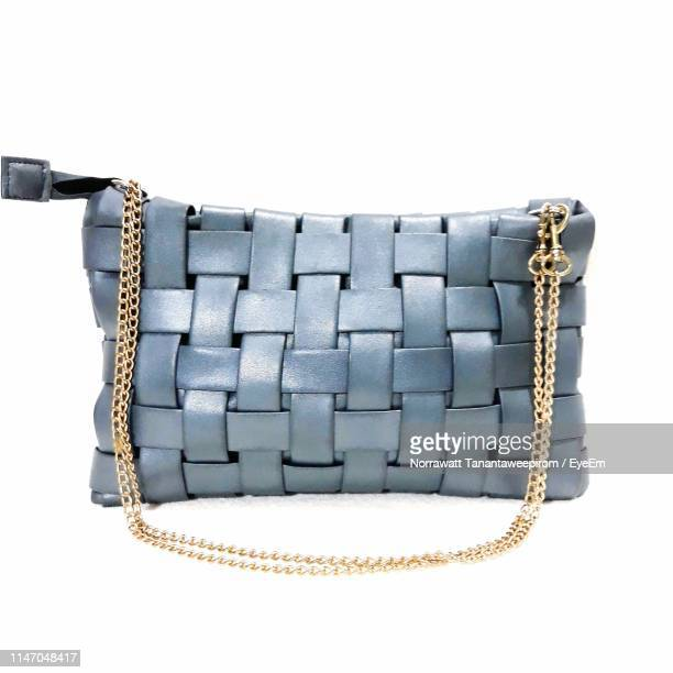 close-up of leather purse over white background - handbag stock pictures, royalty-free photos & images