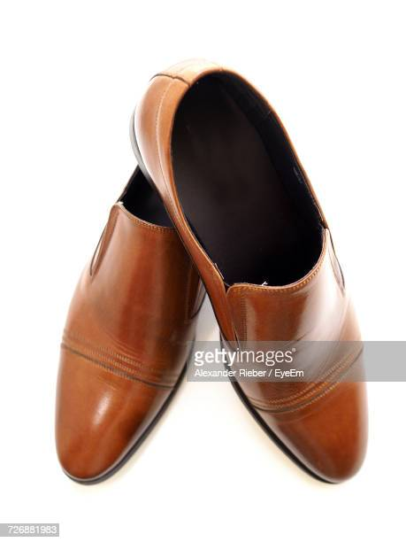 Close-Up Of Leather Shoes Against White Background