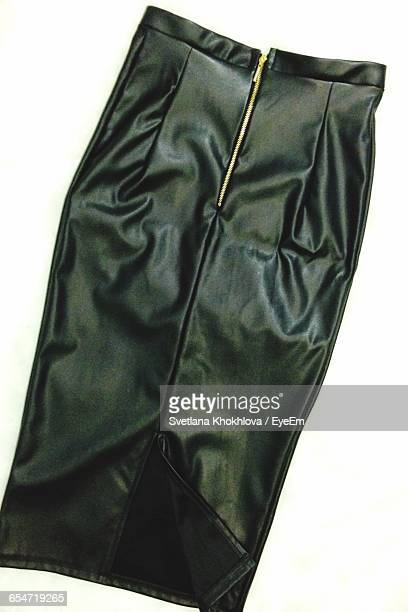 close-up of leather skirt against white background - leather skirt stock pictures, royalty-free photos & images