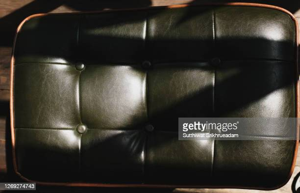 close-up of leather upholstery against sunlight - vehicle interior stock pictures, royalty-free photos & images