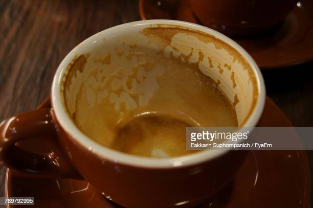 Close-Up Of Leftovers In Coffee Cup On Table
