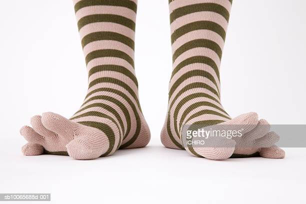 close-up of legs in striped socks, low section - つま先 ストックフォトと画像