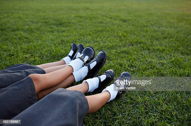 closeup of legs of 3 schoolgirls in uniforms - black shoe stock pictures, royalty-free photos & images