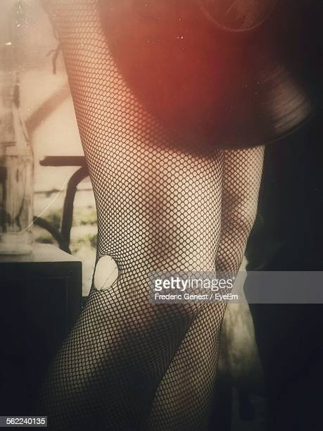 close-up of legs wearing fishnet stockings - fishnet stockings stock pictures, royalty-free photos & images