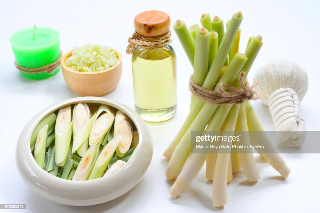 Close-Up Of Lemon Grass In Bowl With Oil On White Background : Stock Photo