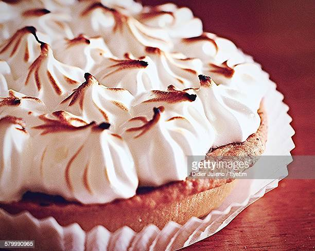close-up of lemon meringue pie served on table - meringue stock pictures, royalty-free photos & images